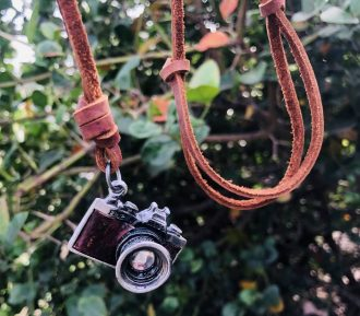 leather necklace camera